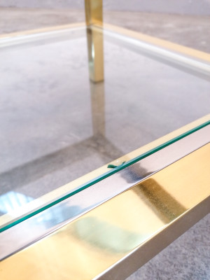 Coppia di tavolini da fumo di design in vetro e metallo. Italia, Anni 60/70