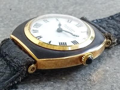 Orologio da polso PHILIP WATCH movimento meccanico a carica manuale, cassa in lacca e metallo dorato, fondo cassa trasparente. Svizzera, Anni 50/60