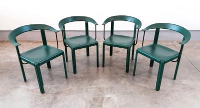 Set di quattro sedie in pelle verde e metallo riferibili alla produzione della Ycami Collection. Italia, Anni 80