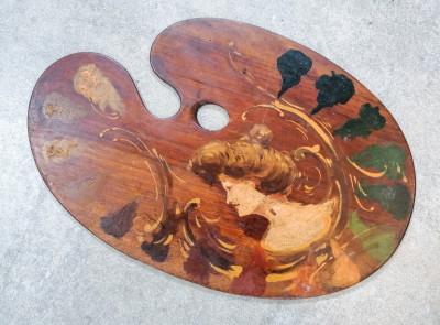 Tavolozza da pittore dipinta a olio con volto di donna. Italia, Primo Novecento